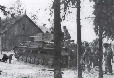 Pzkpfw IV tank and infantry